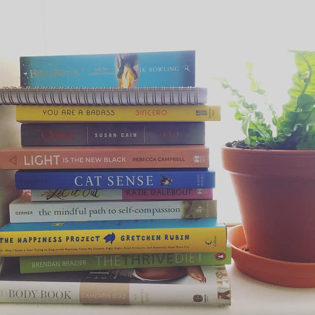 A tall stack of books is a mainstay on my bedside table